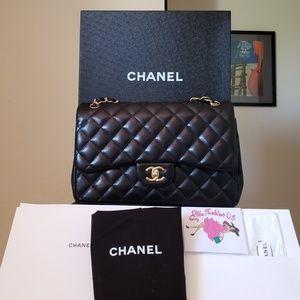 Chanel jumbo black Lambskin gold hardware bag